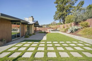 The landscaped backyard comes with programmable irrigation and plenty of room for entertaining.
