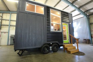 Tiny Mountain Houses builds their tiny homes with three goals in mind: craftsmanship, comfort, and affordability. Their customizable models feature hand-selected wood and are available in both single-level and lofted floor plans. This model, the Little Tahoma Peak 18', starts at $46,750. Tiny Mountain Houses offices in Salem, Oregon, and Roseville, California.