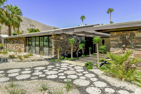 Originally built in 1957, this Twin Palms home was designed by William Krisel. Recently, the home was renovated with an updated kitchen and bathrooms that remain true to the residence's midcentury character.