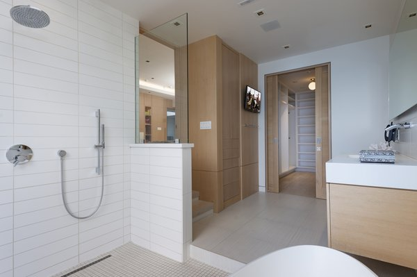 The bathroom is covered in tiles, and the master shower is open. At the rear is a closet.
