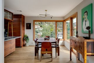The open plan flows into the dining room, which also offers views of the hills.