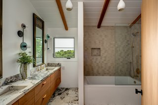 The principal bath has been updated with an elegant mix of materials and a deep soaking tub.