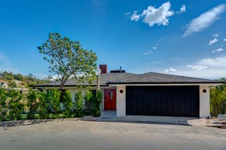 Behind this unassuming midcentury facade lies a beautifully updated home with spectacular views.