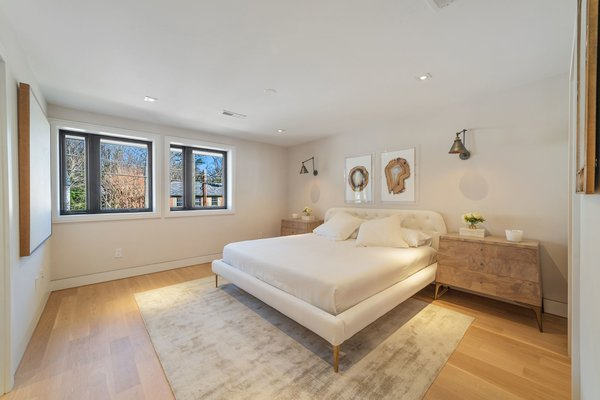 The master suite is located on the main level and has a large walk-in closet.