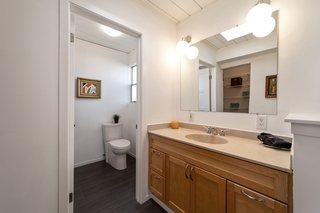 The master bath is not original and could use a refresh.