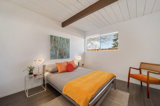 This bedroom with a window neatly tucked into the corner is more typical of Eichler models.