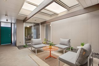 The central atrium has a strong indoor/outdoor feel. An operable cover can close the area off to the elements.