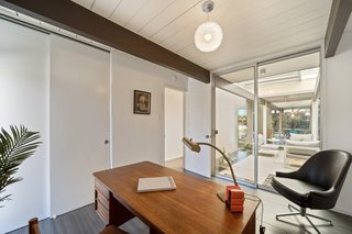 One of the four bedrooms is perfectly suited to be a home office.