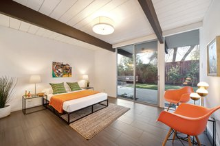 The master bedroom enjoys lots of natural light thanks to sliding doors which lead out to the backyard.