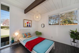 The second bedroom is bright, with more windows that your average Eichler bedroom.