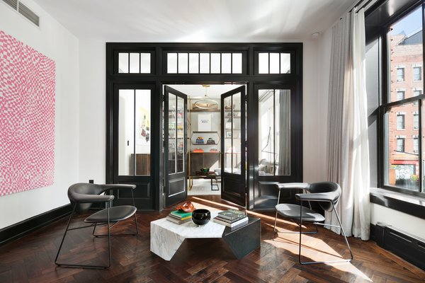 Full-height French doors lead to the second bedroom which is currently in use as a media room. The elegant built-in bookcase is from Amuneal's Collector's Shelving system and was custom made in Philadelphia.