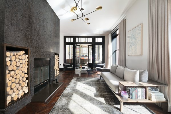 The dramatic, flamed granite, wood-burning fireplace is the focal point of the living room which is divided into three distinct sitting areas.