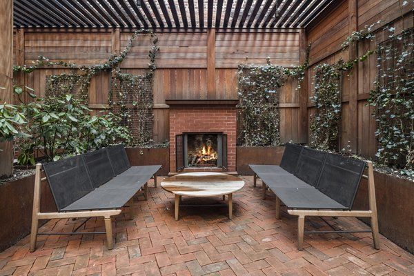 An expansive outdoor terrace—especially one with a wood-burning fireplace is a rare find in a downtown Manhattan full-service building.