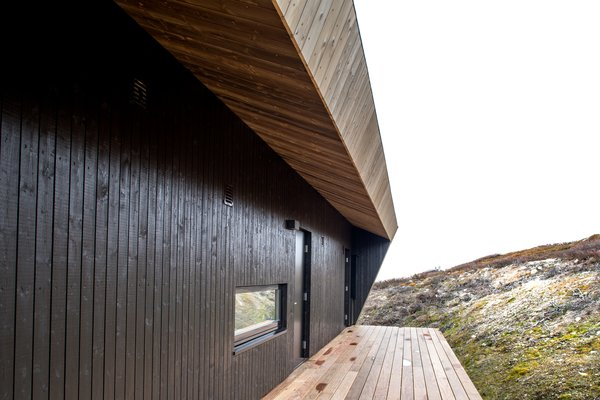 """The ore pine roof prevents rain from dribbling down the cabin's """"neck,"""" where the main entrance is."""