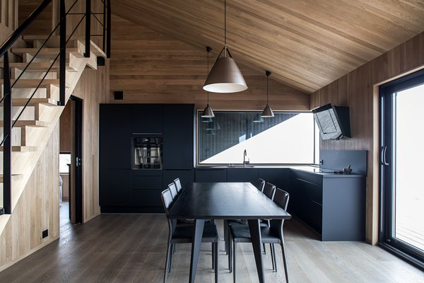 The open kitchen/dining area is a dramatic black.