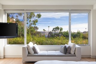 An expansive picture window in the master bedroom frames a gorgeous L.A. view.