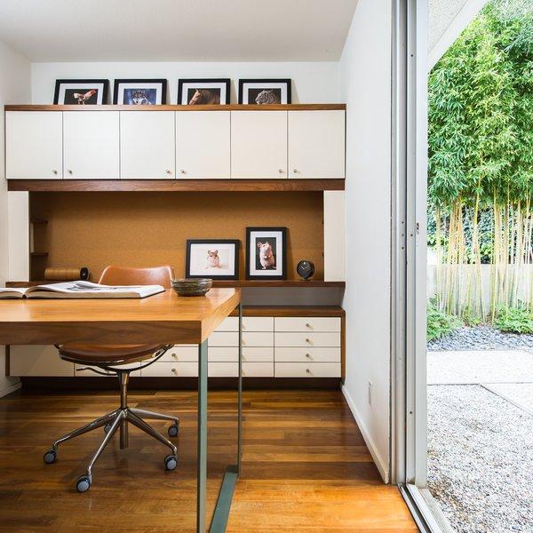 Full-height sliding glass doors enable indoor/outdoor living.