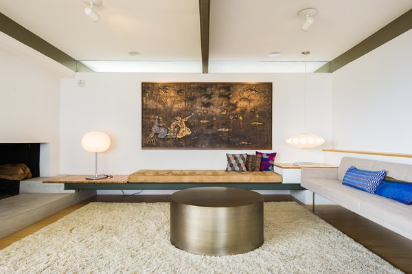 The minimalist living room includes built-in seating.