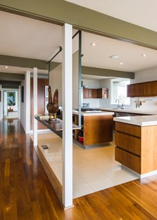 The gourmet kitchen features panoramic views and Sub-Zero, Viking, and Fisher Paykel appliances.