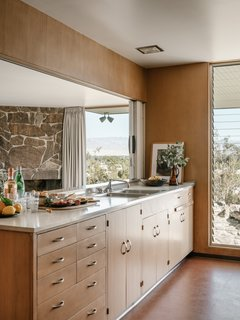 The kitchen looks out on desert views.
