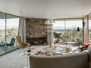 The fireplace that anchors the living space features native rock plucked from the site.