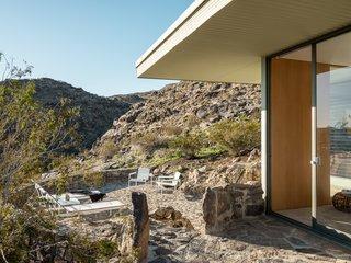 Sliding glass doors enable indoor/outdoor flow.
