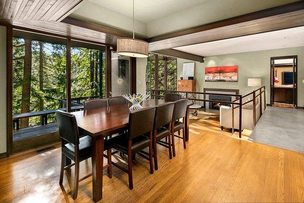The dining area overlooks the sunken living room.