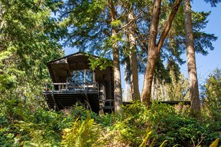 The home is perched on a hill overlooking Hidden Lake.