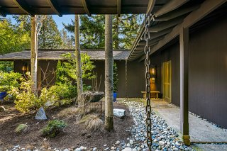 Overhanging eaves provide shelter from the rainy Pacific Northwest climate.