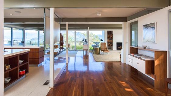 The open-plan layout is bright and airy.  Photo 3 of 11 in An L.A. Midcentury Home With Spectacular Views Lists For $3.8M