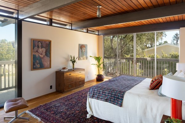 The serene master bedroom has a strong indoor/outdoor connection.