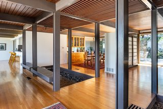 The entry flows into the kitchen, dining room, living room, and straight out the back.