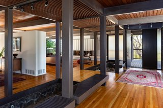 The entry is set apart from the living space by two sunken gardens.