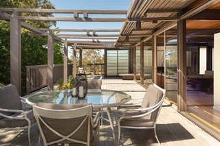 Long decks wrap the house and integrate with the interior via sliding glass doors.