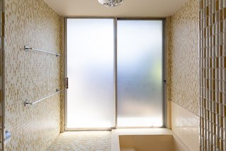 The vintage master bath has a deep soaking tub, inspired by Japanese bathing culture.