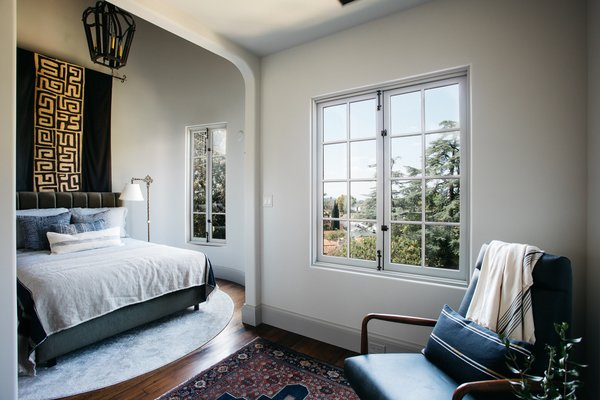 This bedroom is tucked in the turret of the Tudor-style home.