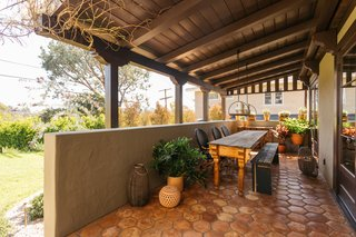 There is a covered patio for alfresco dining.