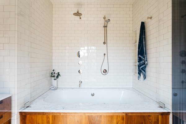The subway tiles that cover the master bath are from Daltile.