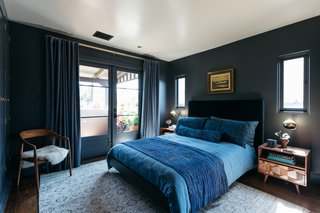 The master suite is a dark and moody retreat.