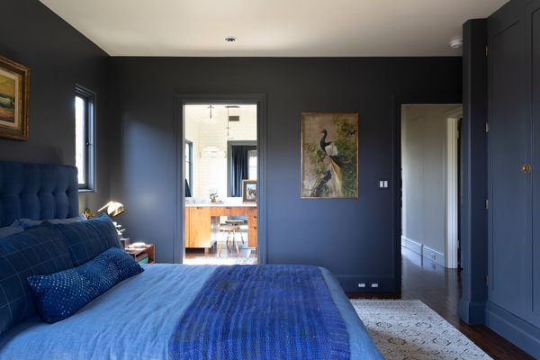 """""""It's okay to be bold,"""" Henderson says of the indigo-hued bedroom. """"I'm still under the impression that almost everyone loves blue, so I think this is not only okay to do, but actually something that can really add value."""" The color is French Beret from Benjamin Moore."""