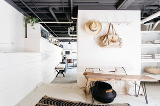 The basement was transformed into a cool, modern office/studio space with an industrial vibe.