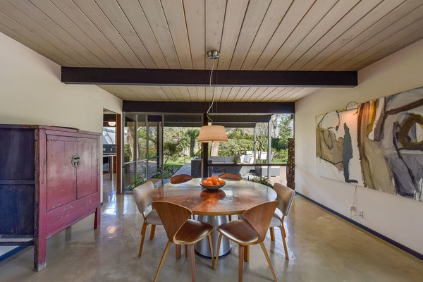 The dining room connects with the living space and leads to the outdoors.