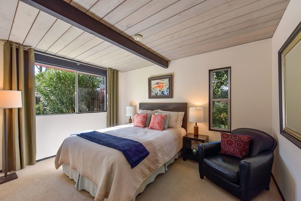 The home features dramatic wood ceilings throughout.