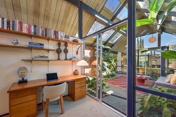 The space is flooded with natural light, and it seamlessly connects to the central atrium.