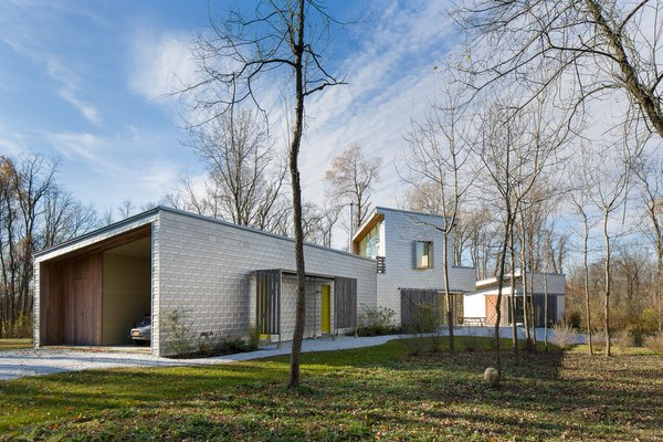 Drawing upon solar efficiency studies, the architects designed deep eaves to shelter the large expanses of glass.
