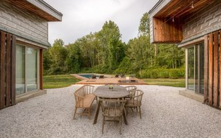 The backyard features an outdoor dining area with a swimming pool, a jacuzzi, an indoor/outdoor shower, and a fire pit.