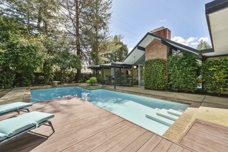 The backyard features a solar-heated pool.