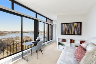 The upper level holds two bathrooms and a study/guest room with access to a large, private roof terrace.