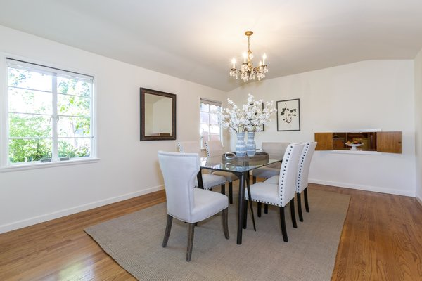 The vintage 1940s dining room features a pass-through window to the kitchen.