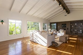 The bright and airy great room features a vaulted tongue-and-groove ceilingand a slightly more modern feel than the rest of the home.